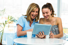 Mother and daughter watch tablet Stock Photos