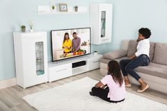 Mother And Daughter Watching Television Royalty Free Stock Photography