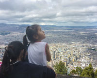 Mother and Daughter Watching the Panoramic of Bogota from Monser Stock Photo