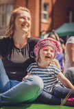 Mother and daughter watching street theater Royalty Free Stock Photography