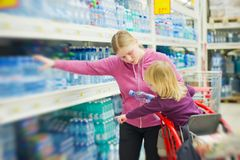 Mother and daughter in water section in shop Royalty Free Stock Photography