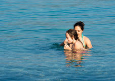 Mother and daughter in water Stock Photo