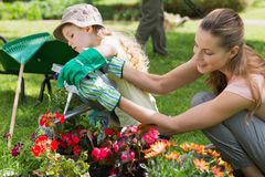 Mother and daughter watering plants at garden Royalty Free Stock Image