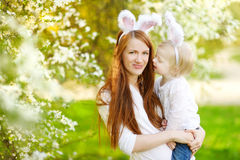 Mother and daughter wearing bunny ears on Easter Stock Images