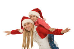 Mother with daughter  wearing Christmas caps Stock Photo