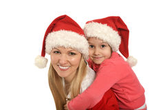Mother with daughter  wearing Christmas caps Royalty Free Stock Image
