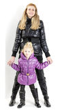 Mother and daughter wearing jackets Royalty Free Stock Image