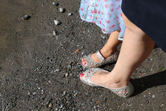 Mother and daughter wearing sandals Stock Photos