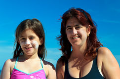 Mother and daughter wearing sunscreen Royalty Free Stock Images