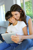 Mother and daughter websurfing on tablet Royalty Free Stock Photography