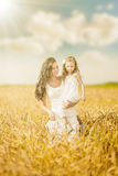 Mother and daughter among wheat ears Royalty Free Stock Photography