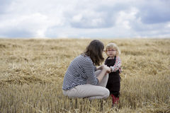 Mother and daughter in a wheat field Stock Photos