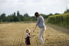 Mother and daughter in a wheat field Royalty Free Stock Image