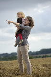Mother and daughter in a wheat field Royalty Free Stock Photo