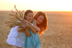 Mother with daughter at the wheat field Royalty Free Stock Photography