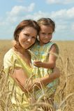 Mother and daughter at the wheat field Stock Images