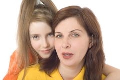 Mother and the daughter on a white background. Portrait of mother and the daughter on a white background Royalty Free Stock Photos