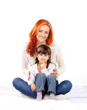 Mother and daughter  on white background Stock Photos