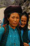 Mother and daughter of the White Hmong ethnic. White Hmong women from the region of Ha Giang in northern Vietnam. The mother and daughter have maintained their Royalty Free Stock Photos