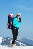 Mother and daughter in winter mountains Royalty Free Stock Photo