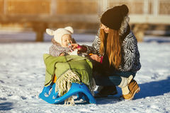 Mother and daughter in winter outdoors stock image