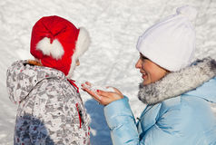 Mother and daughter in winter park Stock Photos