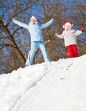 Mother and daughter in winter park Royalty Free Stock Photo