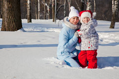 Mother and daughter in winter park Royalty Free Stock Images