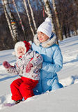 Mother and daughter in winter park Stock Photo
