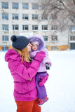 Mother and daughter in winter park Stock Images