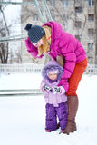 Mother and daughter in winter park Royalty Free Stock Image
