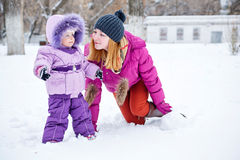 Mother and daughter in winter park Stock Photography