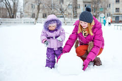 Mother and daughter in winter park Royalty Free Stock Photography