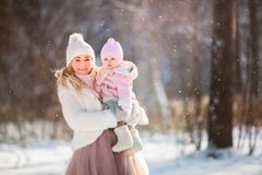 Beautiful Mother and daughter winter portrait royalty free stock photography