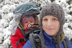 Mother and daughter on a winter walk Stock Images