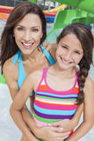 Mother Daughter Woman Girl Child Family Water Park. A happy family of mother and daughter, women and girl child, having fun on vacation at a water park Stock Image