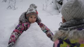 Mother with the daughter in the wood. The girl  the child cheerfully spend time rushing snowballs. Winter rest, brin stock video footage