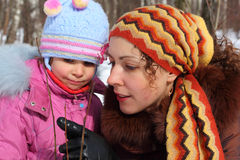 Mother and daughter in wood in winter closeup Stock Photos