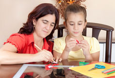 Mother and daughter working on an art project Stock Photo