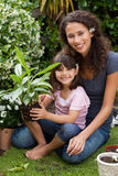 Mother and daughter working in the garden Royalty Free Stock Images