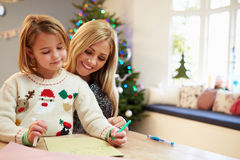 Mother And Daughter Writing Letter To Santa Together stock photography