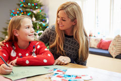 Mother And Daughter Writing Letter To Santa Together Stock Images