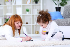 Mother  and daughter writing together Royalty Free Stock Photos