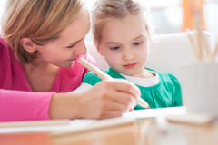 Mother and daughter writing together Royalty Free Stock Images