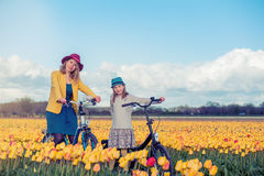 Mother and daughter in a yellow tulips field Royalty Free Stock Images