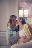 Mother and daughter. Young pregnant women and her daughter have a moment of tenderness Stock Image