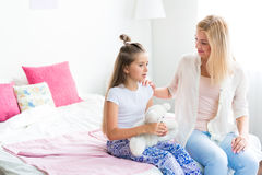 Mother and daughter. Young women talking to her daughter at home Stock Photos