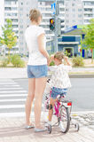 Mother and daughter on zebra crossing. Royalty Free Stock Images