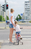 Mother and daughter on zebra crossing. Stock Photography