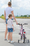 Mother and daughter on zebra crossing. Royalty Free Stock Photo